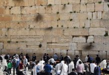 Praying at the Wailing Wall in Jerusalem