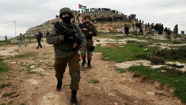Israeli soldiers attack Palestinians holding a vigil on Nablus-area mountain