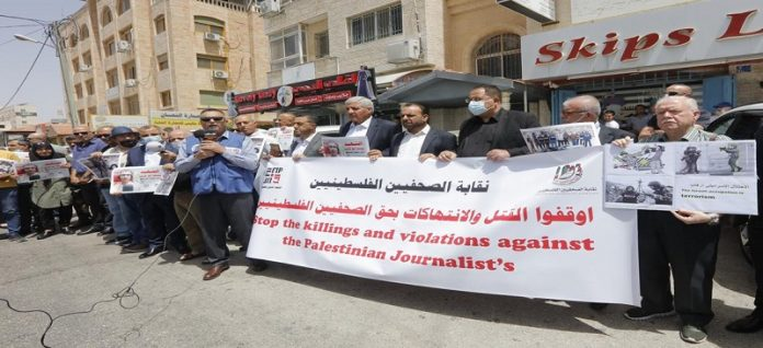 Palestinians hold a sit-in to protest Israeli targeting of journalists